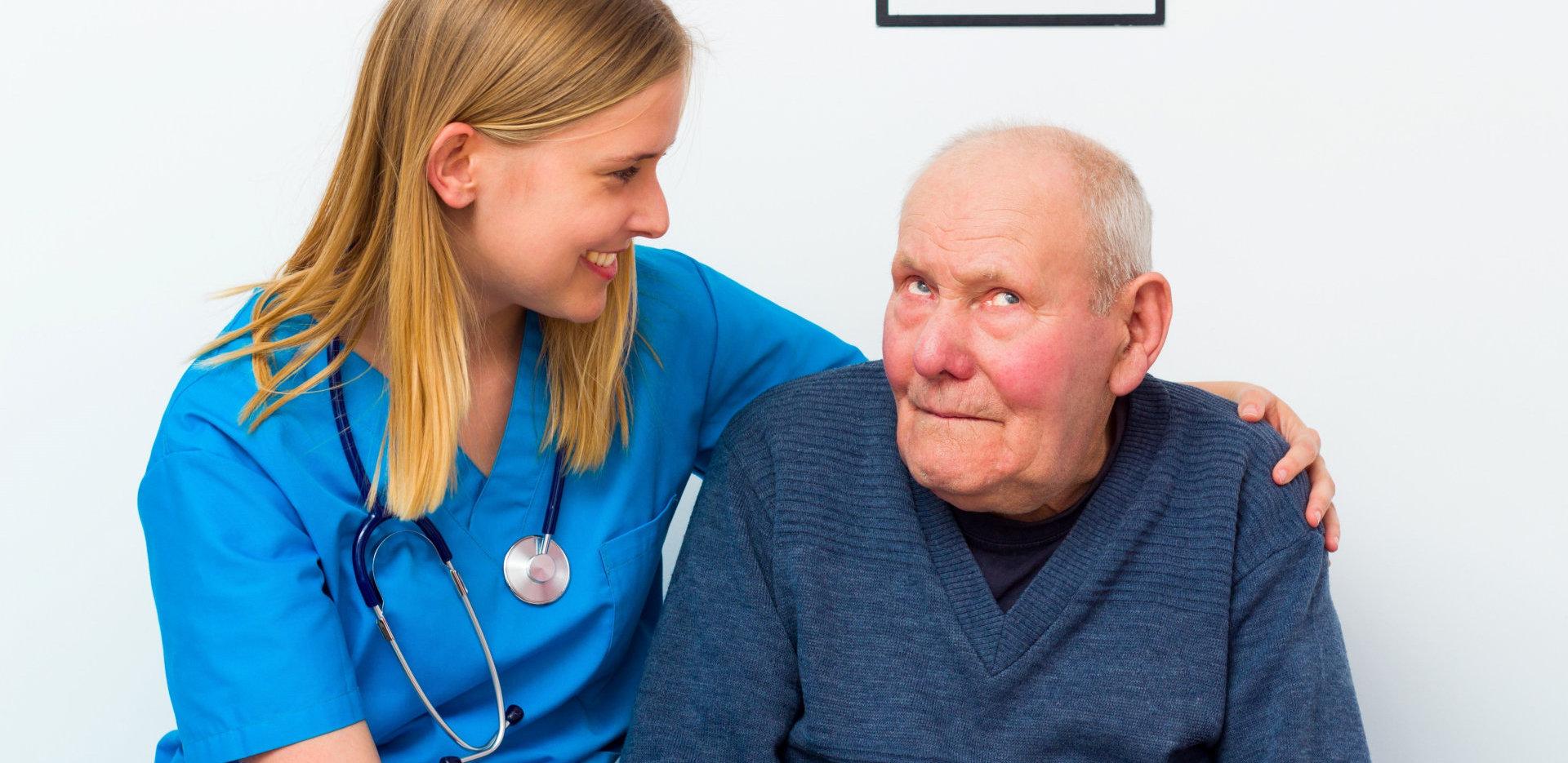 nurse taking care of senior man