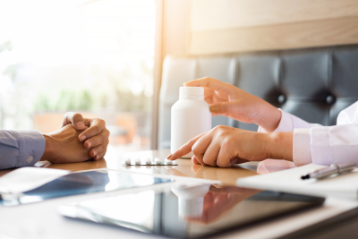 two people discussing medicines