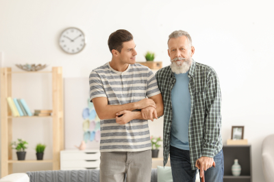 male caregiver assisting his senior patient