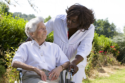 senior woman on a wheelchair with her caregiver