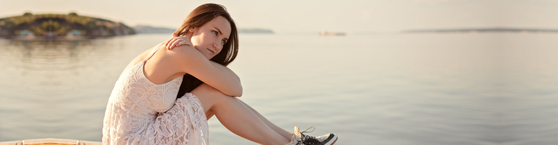 girl sitting on the pier
